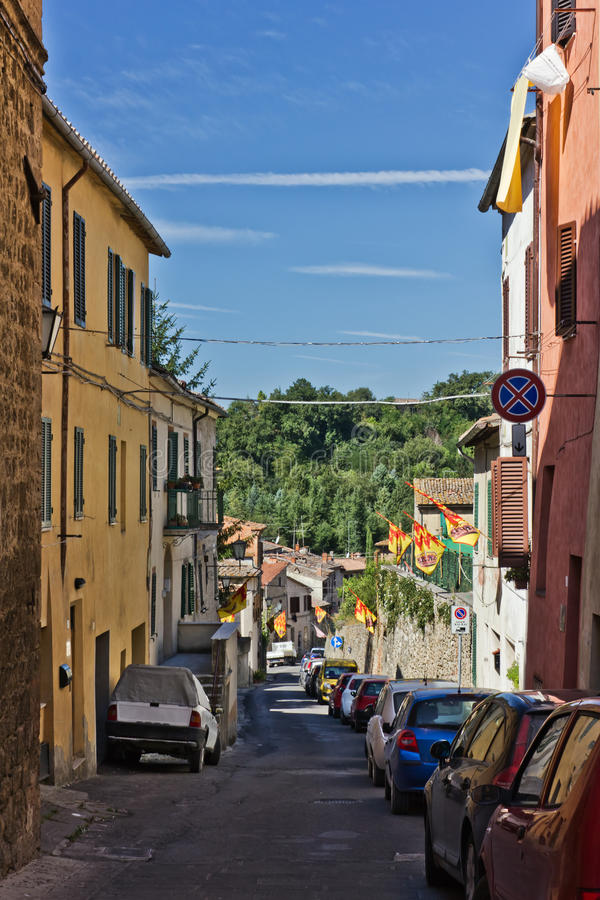Narrow street of Asciano, Italy royalty free stock image