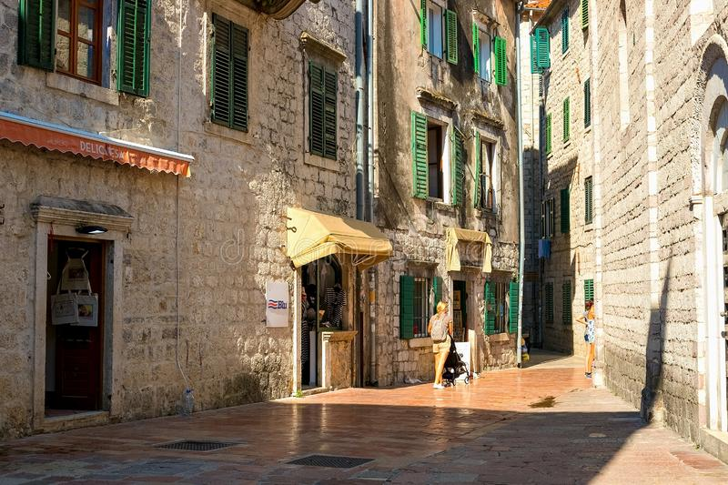The narrow street of the authentic old town of Kotor, Montenegro. royalty free stock image