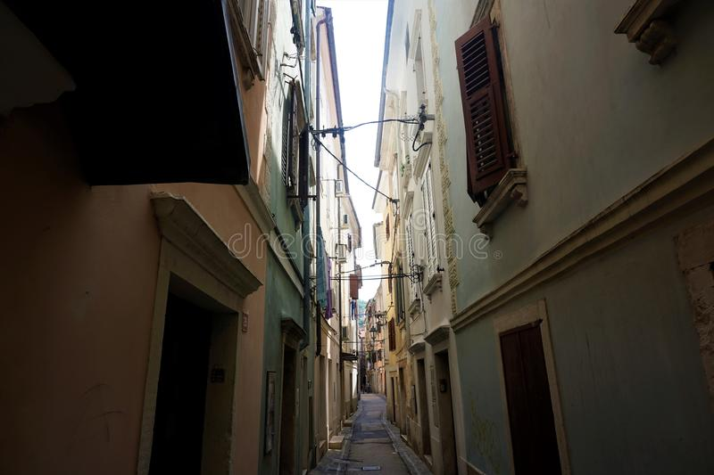 Narrow street in the backstreets of Piran stock photography