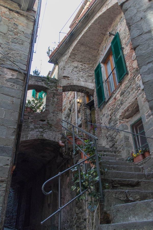 Narrow street with a balcony in Corniglia, Liguria, Italy royalty free stock photography