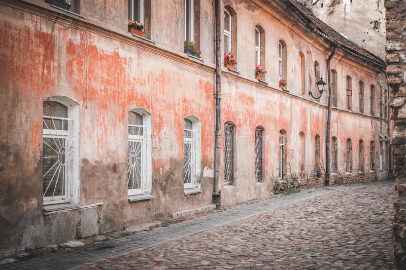 Narrow street and buildings in old town, Vilnius, Lithuania stock photos
