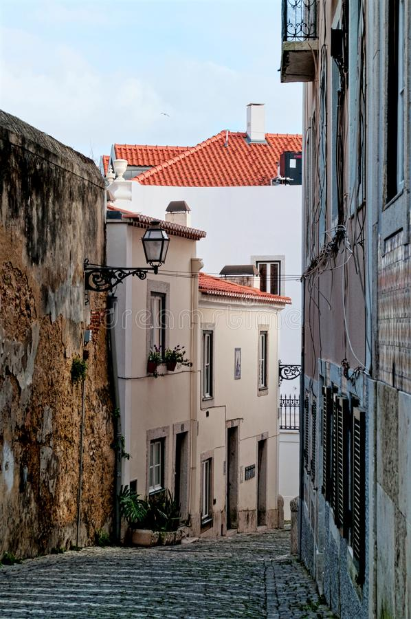 Narrow street in the city of Lisbon. Portugal royalty free stock photos