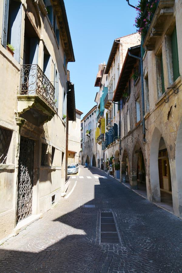 Narrow street and decayed walls in Asolo, Italy royalty free stock images