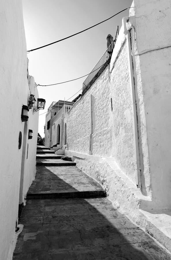 Narrow street in greek village stock image