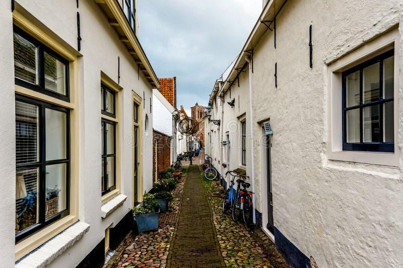 Narrow street in the historic village of Elburg stock photos