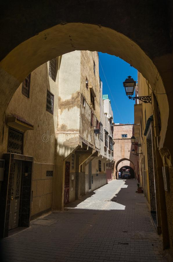 Narrow street in medina of medieval imperial city of Meknes. Morocco. stock photo