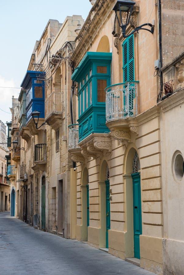 Narrow street in Mosta, Malta. Narrow Mediterranean alleyway in the medieval city of Mosta, Malta royalty free stock photos