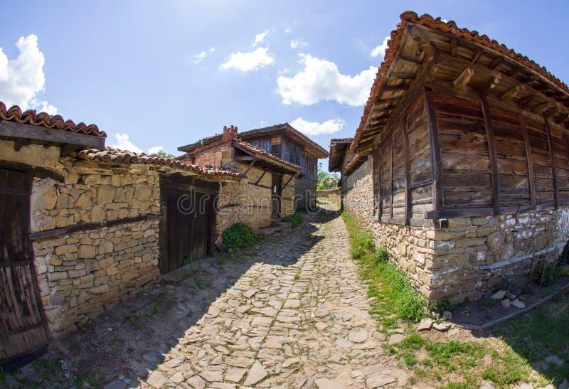Narrow street in the mountainous Balkan village stock photos