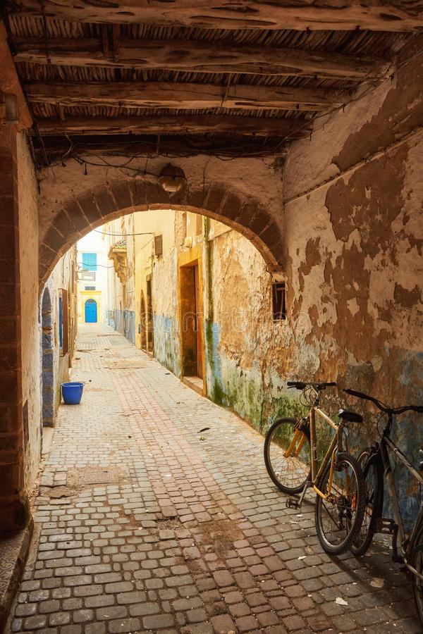 Narrow street of the old city with beige and white walls of the residential houses. stock photo