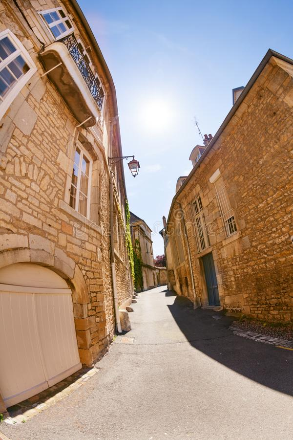 Narrow street of old city in Besancon at sunny day royalty free stock photo