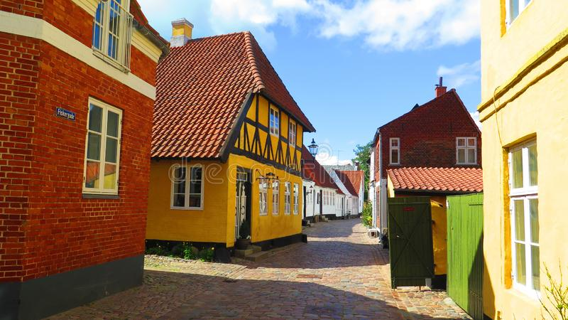 Narrow street with old painted houses in Ribe town center, Denmark stock images