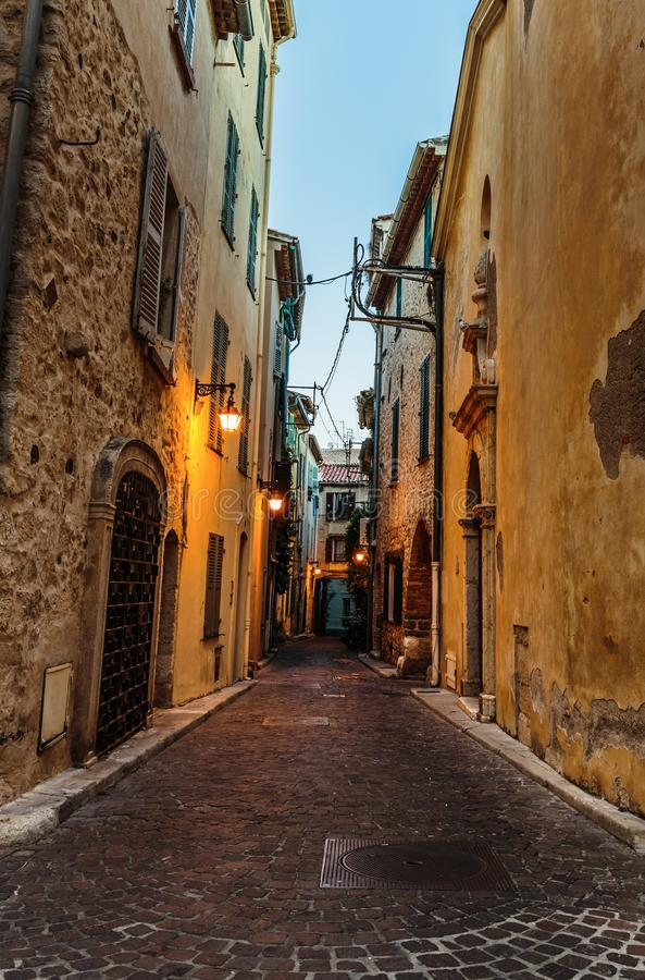 Narrow street in the old town Antibes in France. Night view royalty free stock image