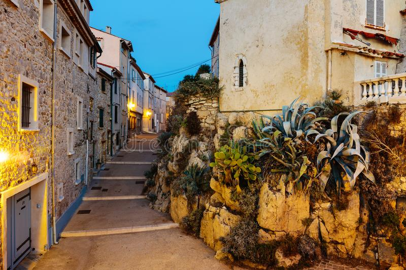 Narrow street in the old town Antibes in France. Night view royalty free stock photos