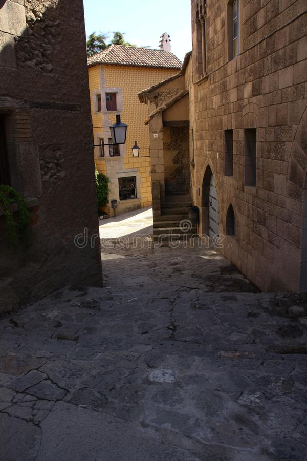Narrow street in the old town of Barcelona. stock photos