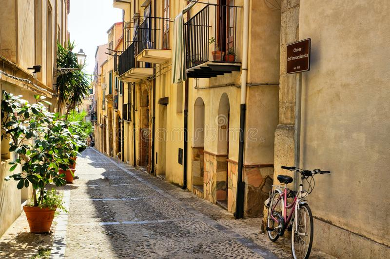 Narrow street in the old town of Cefalu, Sicily, Italy. Narrow street in the old town of the Mediterranean village of Cefalu, Sicily, Italy stock photos