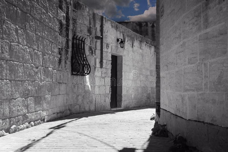 Narrow street in old town of Gharghur, Malta. A typical Narrow street in old town of Gharghur, Malta royalty free stock photo