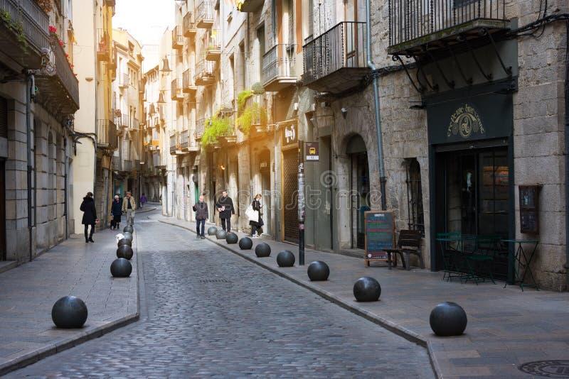Narrow street in old town. Girona, Catalonia, Spain royalty free stock image