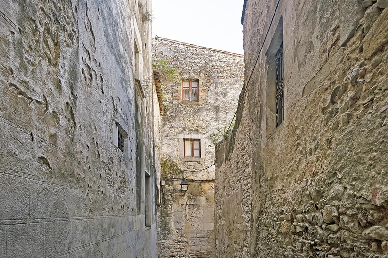 Narrow street in old town of Girona royalty free stock image