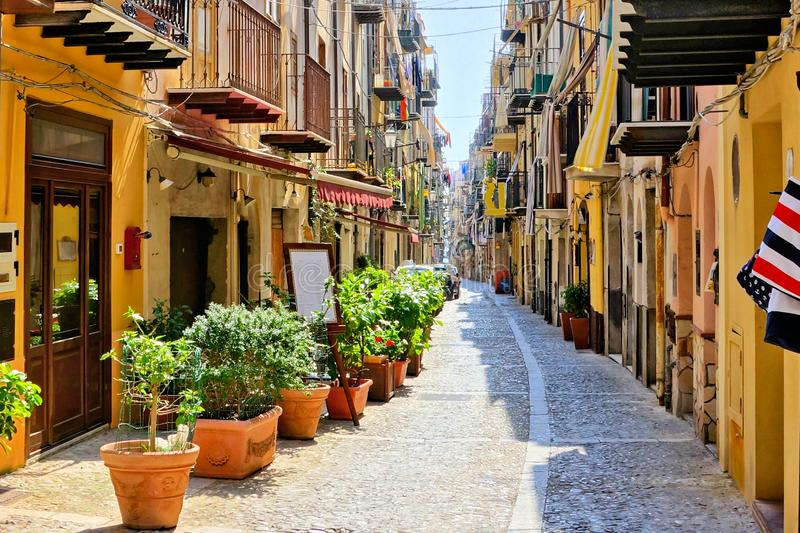Narrow street in the old town of Cefalu, Sicily, Italy. Narrow street in the old town of the Mediterranean village of Cefalu, Sicily, Italy royalty free stock images