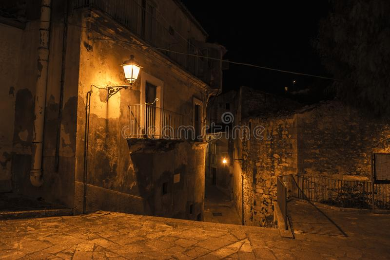 Street of the old town at night in Ragusa, Sicily, Italy royalty free stock images