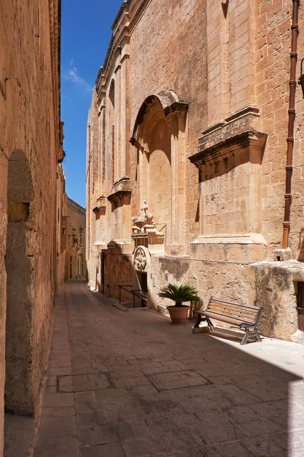 The narrow street and residential houses of Mdina, the old capital of Malta. In the limestone surroundings. The narrow medieval stone paved street and stock images