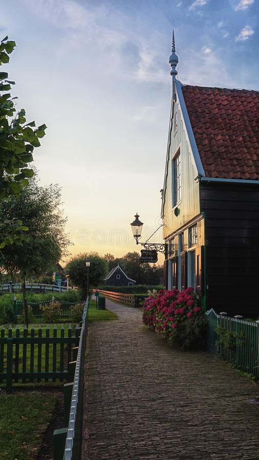 The narrow street in the small village of Zaanse Schans. Zaanstad, Netherlands, July 17, 2014: The Zaanse Schans with its windmills, typical green wooden houses royalty free stock images