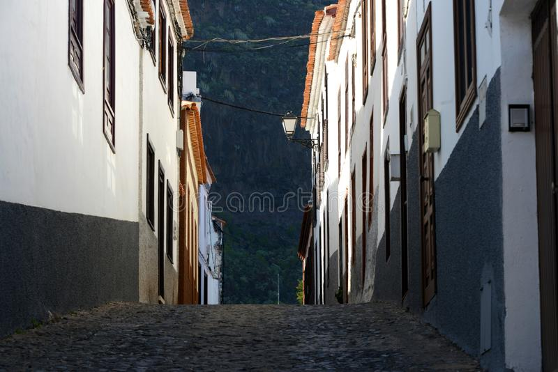 Street in Agulo on la Gomera. Narrow street in traditional mediterranean village stock images