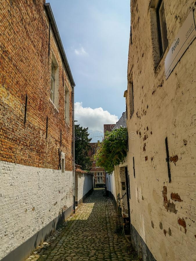 Narrow street in the Unesco protected beguinage in the city center of Lier, Belgium. In Antwerp province royalty free stock photography