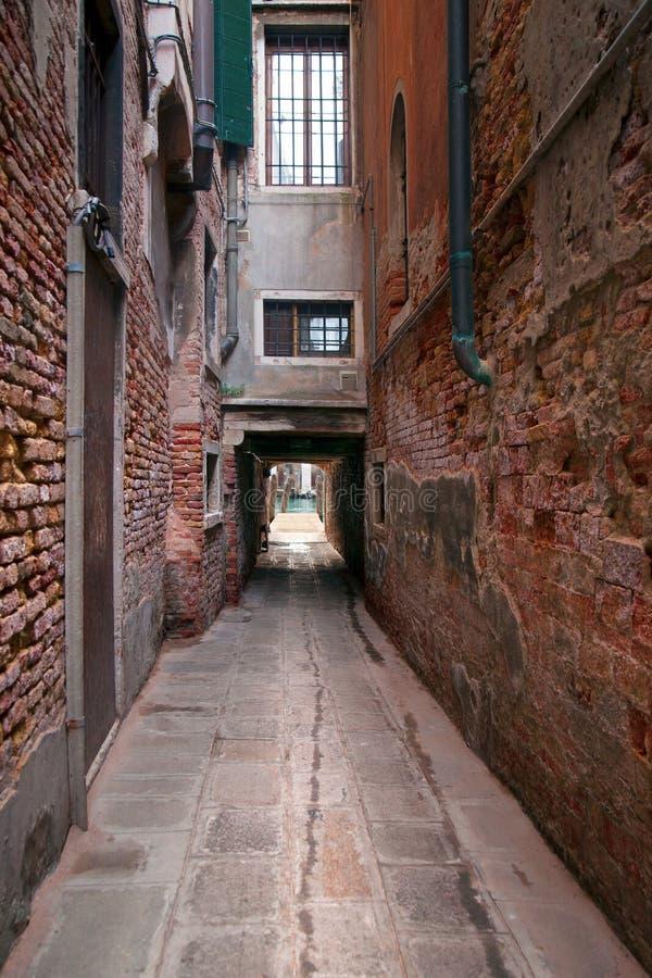 Narrow street in Venice stock photo