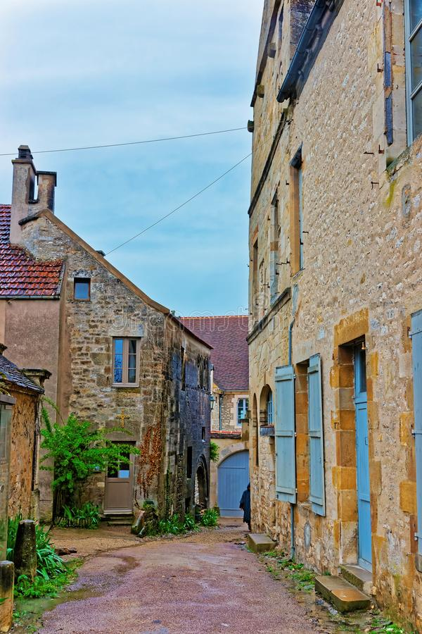 Narrow Street of Vezelay at Bourgogne Franche Comte in France. Narrow street of Vezelay in Avallon of Yonne department at Bourgogne Franche Comte region, France royalty free stock photo