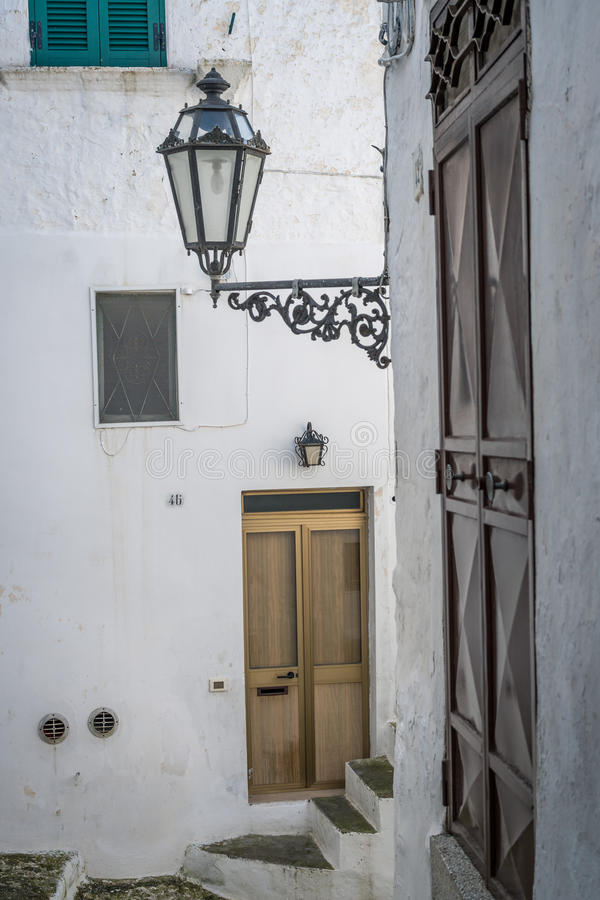 Narrow street in white city of Ostuni, Puglia, Italy stock images
