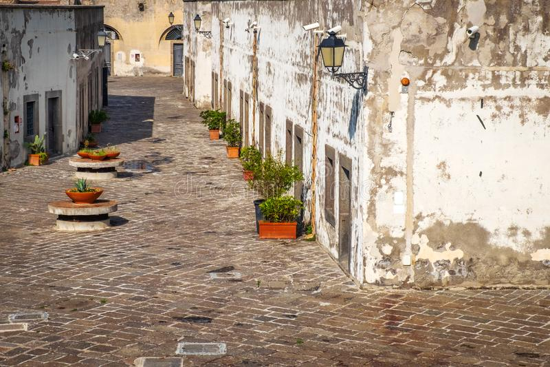 Narrow streets with CCTV security cameras in the old part of Europe. Narrow streets with CCTV security cameras for riot protect in the old part of Europe, Italy royalty free stock photos