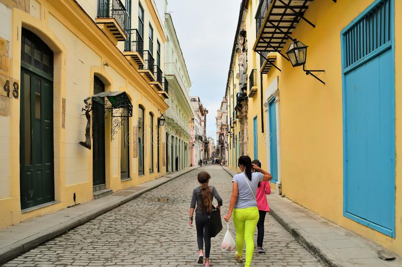 On the narrow streets of the historical center of Havana, old houses, pavement made of stone, old street lamps on the walls of hou stock image