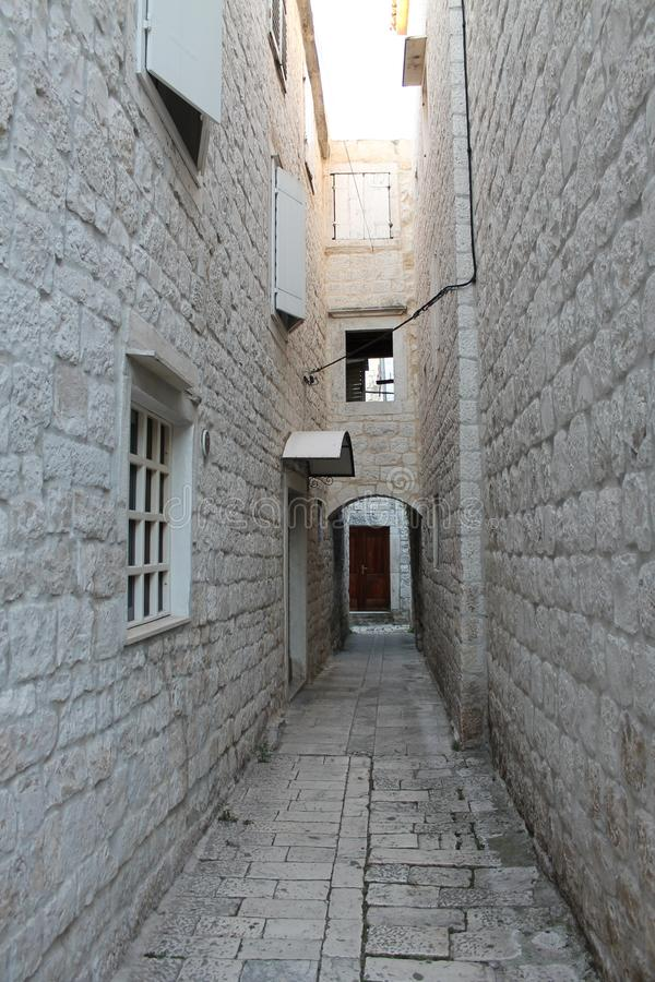 Narrow streets of Trogir, Croatia with white stone houses in the old town royalty free stock photo