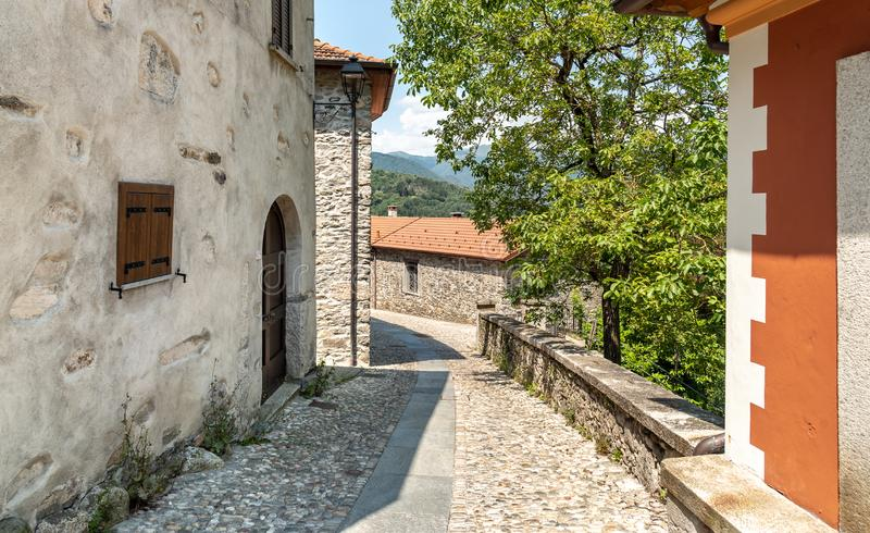 Narrow streets wit stone houses in the small mountain village of Bassola, Piedmont, Italy. Narrow streets wit stone houses in the small mountain village of stock image