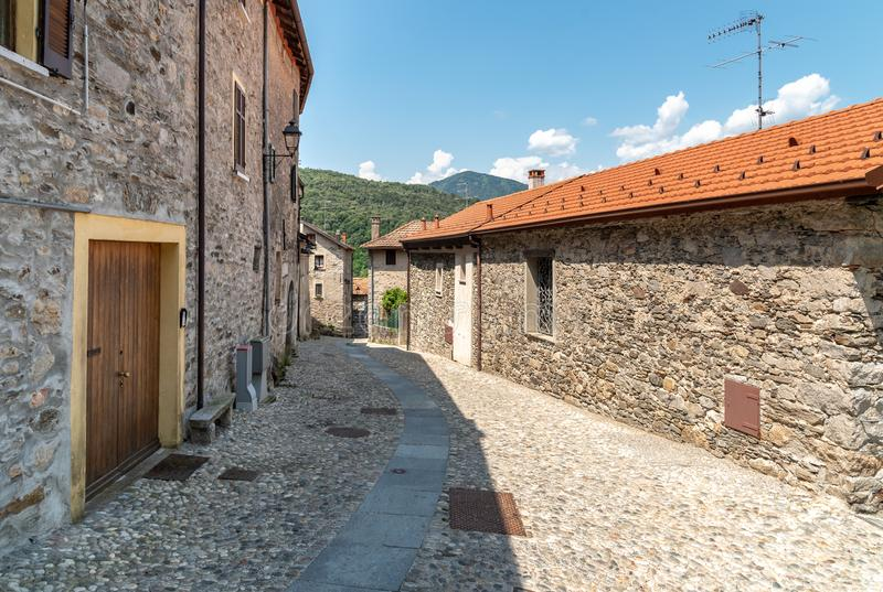 Narrow streets wit stone houses in the small mountain village of Bassola, Piedmont, Italy. Narrow streets wit stone houses in the small mountain village of royalty free stock photo