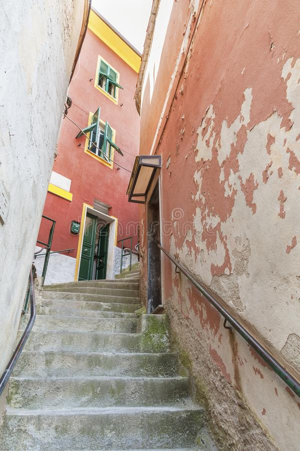 Narrow uphill alley. In resort village Vernazza, Cinque Terre, Italy royalty free stock photography