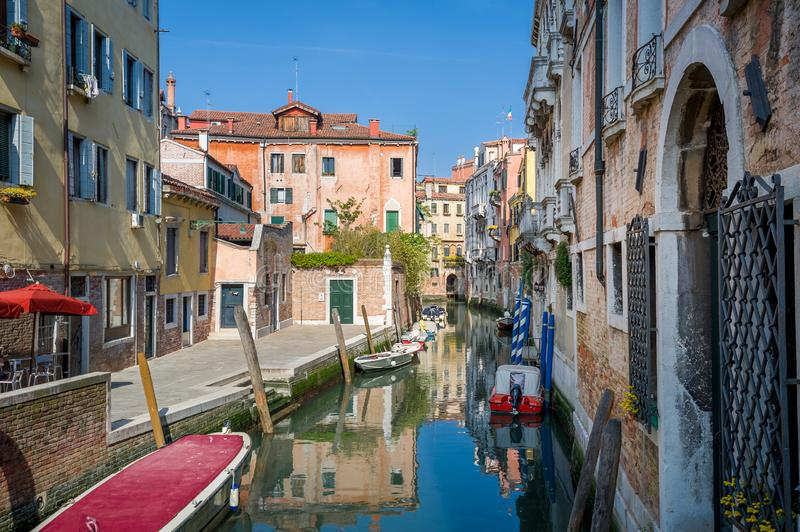 Narrow water channel in the center of Venice old town royalty free stock photos