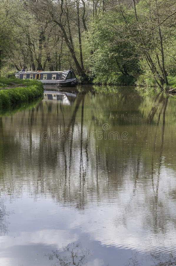 A narrowboawboat on the River Churnet in Staffordshire, England stock photos