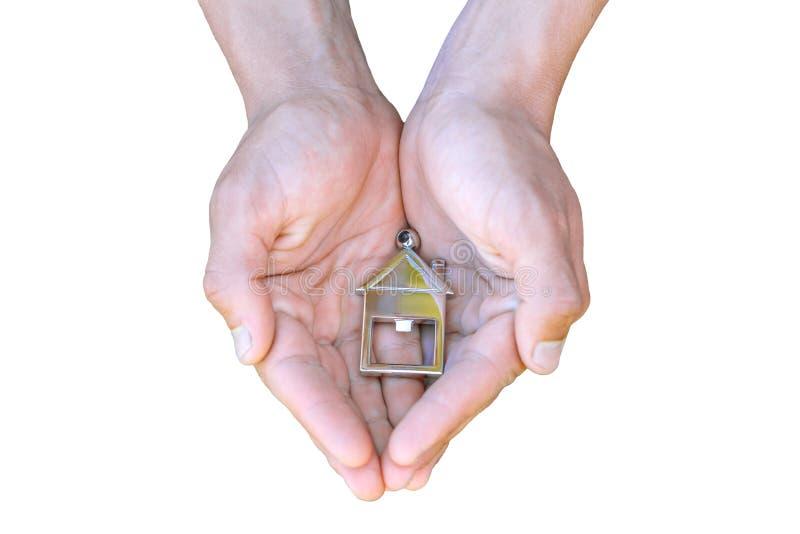 Nas mãos do conceito branco da casa do fundo do alojamento imagem de stock royalty free