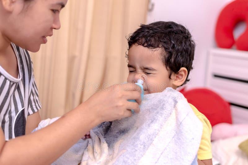 Nasal irrigation, Parent flushing child's nose royalty free stock photos