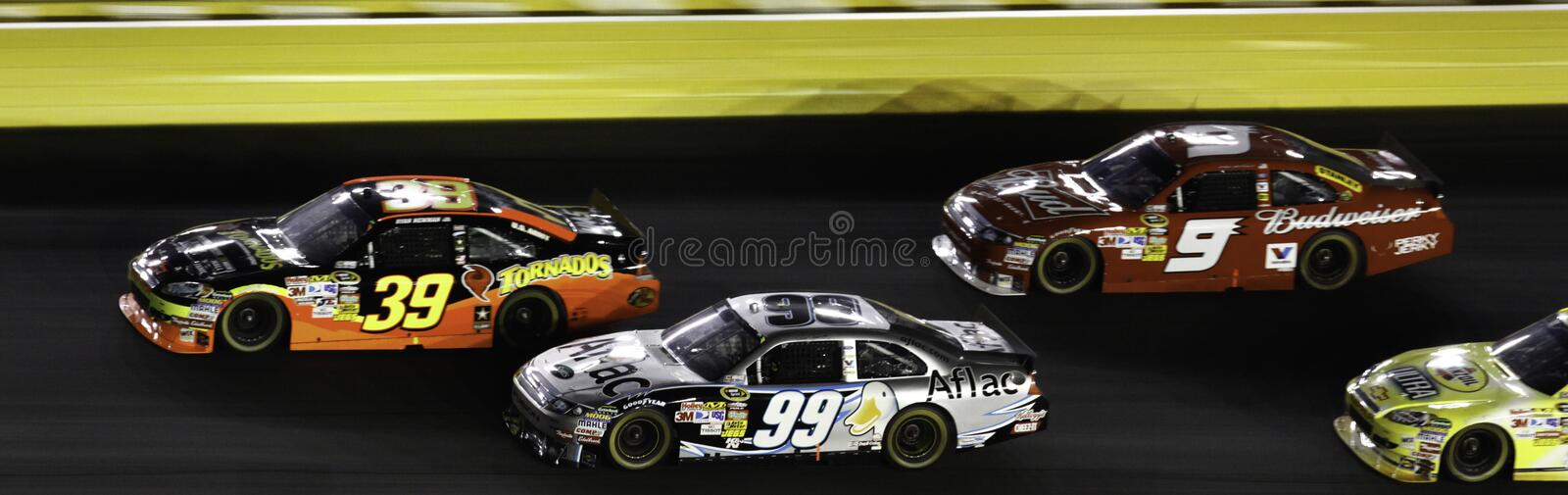 NASCAR - 2010 All Stars Newman, Edwards and Kahne. NASCAR All Stars Ryan Newman #39,, Carl Edwards #99 and Kasey Kahne #9 run on the track at Charlotte Motor stock images