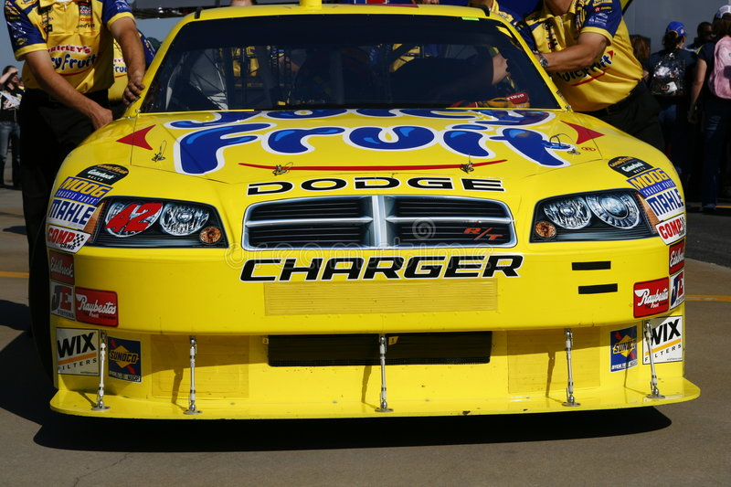 NASCAR All Star Juan Pablo Montoya. Juan Pablo Montoya's #42 Juicy Fruit Dodge Charger Car of Tomorrow awaits inspection before the 2008 NASCAR All Star Race at royalty free stock photos