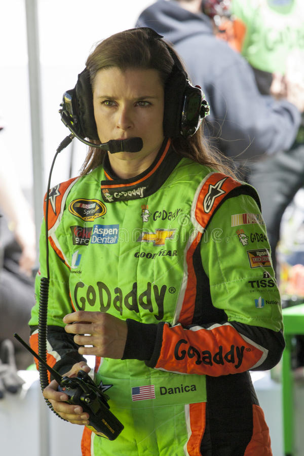 NASCAR: Apr 17 Food City 500. Bristol, TN - Apr 17, 2015: Danica Patrick (10) talks to her crew during a practice session for the Food City 500 at Bristol Motor royalty free stock photo