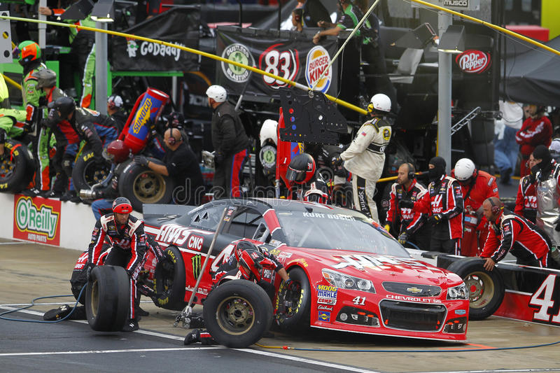NASCAR: Apr 19 Food City 500. Bristol, TN - Apr 19, 2015: Kurt Busch (41) brings his car in for service during the Food City 500 at Bristol Motor Speedway in stock photos