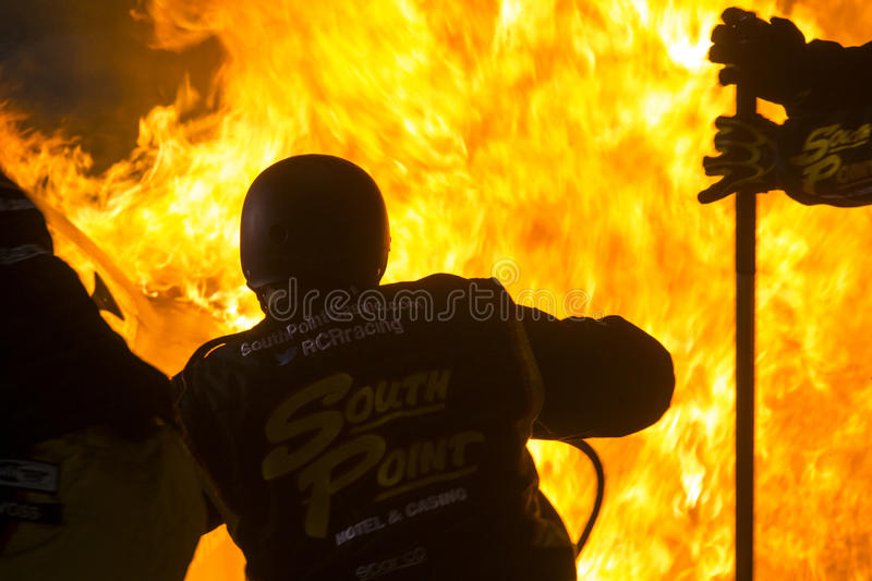 NASCAR: Apr 24 ToyotaCare 250. Richmond, VA - Apr 24, 2015: Brendan Gaughan (62) pulls into the pits on fire during the ToyotaCare 250 at Richmond International royalty free stock images