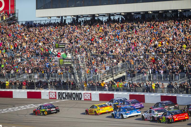 NASCAR: April 21 Toyota Owners 400. April 21, 2018 - Richmond, Virginia, USA: Martin Truex, Jr 78 leads the field to the green flag to start the Toyota Owners royalty free stock photo