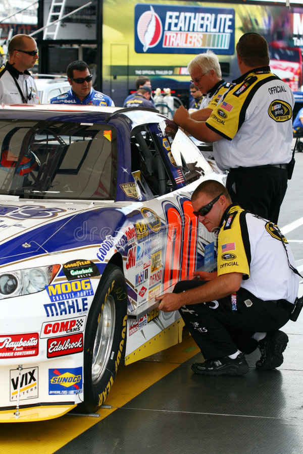 NASCAR - checking the quarter panels. NASCAR officials run Michael McDowell's #00 Aaron's Dream Machine Toyota through the inspection template and scales at royalty free stock images