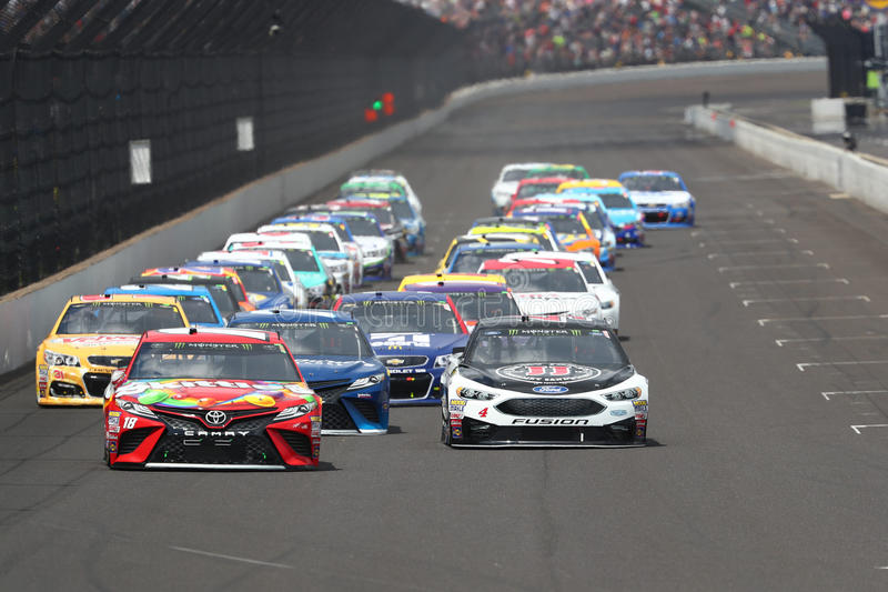 NASCAR: July 23 Brantley Gilbert Big Machine Brickyard 400. July 23, 2017 - Speedway, IN, USA: Kyle Busch 18 battles for position during the Brantley Gilbert Big royalty free stock image