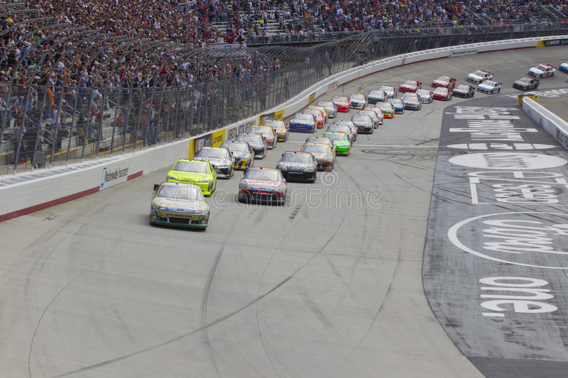 NASCAR: Mar 20 Jeff Byrd 500. BRISTOL, TN - MAR 20, 2011: The NASCAR Sprint Cup Series teams take the green flag for the Jeff Byrd 500 race at the Bristol Motor royalty free stock photo